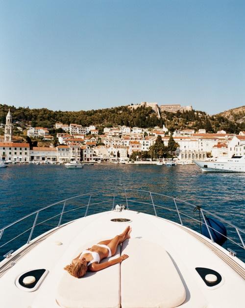 sunbathing on a yacht island holiday